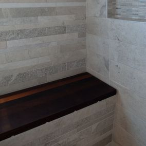 view of a bench in bathroom