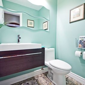 small bathroom with blue paint