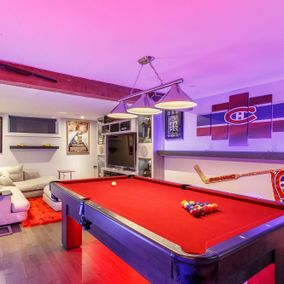 view of a living room with a pool table